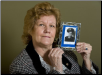 Shirley Hare Shipway, 65, of Strasburg, holds a photo of her brother James R. Hare